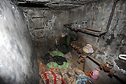 """BEIJING, CHINA - DECEMBER 05: China Out - Finland Out<br /> <br /> Living Underground<br /> <br /> An underground utility compartment outside Lidu Park in Chaoyang district on December 5, 2013 in Beijing, China. Four people have been living in some of the compartments there for at least two years, said security guard Wei Zhonghua. """"They usually come to the park to use the restroom around 8 am, and return quite late in the evening. Sometimes they charge their flashlights in the security guard's room,"""" he said. <br /> ©Exclusivepix"""