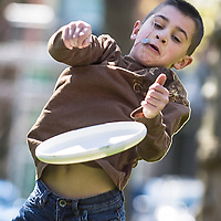 Brodie Savage, 8 of Spokane flubs a frisbee catch by his aunt,Kerry Savage of Vancouver Wednesday.  April 2 ,2008 at Esther Short Park while he and his family enjoyed the warm weather from Spokane while on spring break.<br /> (The Columbian/ N. Scott Trimble)