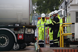 © Licensed to London News Pictures. 04/10/2021. London, UK. Members of the military are seen being given instructions on how to operate an oil tanker at Buncefield oil depot in Hemel Hempstead, Hertfordshire. Military personnel are expected to start helping with driver shortages today following more than a week of long queues and closures at petrol stations. Photo credit: Ben Cawthra/LNP