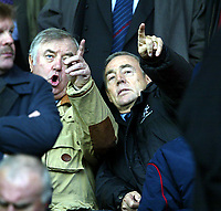 Liverpool fan Jimmy Tarbuck (l) and former player Ian St. John watch the Reds take on Sunderland during the Premiership match at Anfield, Liverpool, Sunday, November 17th, 2002. <br /><br />Pic by David Rawcliffe/Propaganda<br /><br />Any problems call David Rawcliffe on +44(0)7973 14 2020 or email david@propaganda-photo.com - http://www.propaganda-photo.com