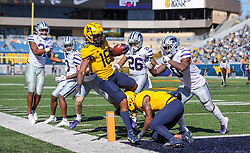 Oct 31, 2020; Morgantown, West Virginia, USA; West Virginia Mountaineers wide receiver Winston Wright Jr. (16) makes a catch and runs for a touchdown during the second quarter against the Kansas State Wildcats at Mountaineer Field at Milan Puskar Stadium. Mandatory Credit: Ben Queen-USA TODAY Sports