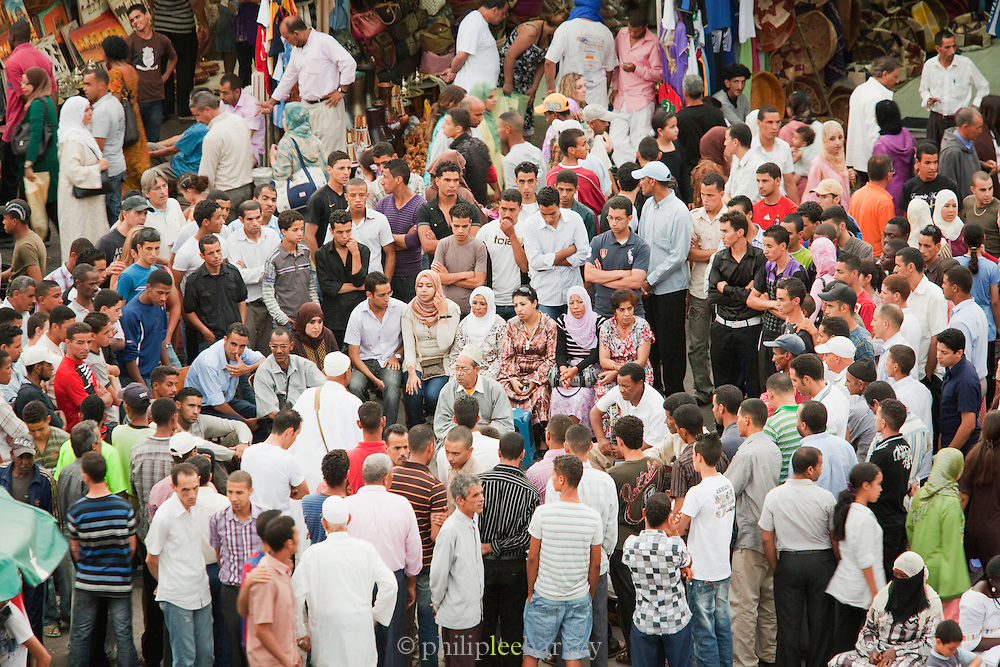 Storytellers entertain the crowds in the Djemaa el Fna in the medina of Marrakech, Morocco