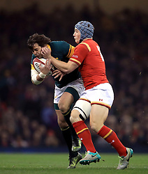 South Africa's Francois Venter (left) and Wales' Scott Williams during the Autumn International match at the Principality Stadium, Cardiff.