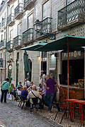 People enjoying afternoon drinks on the 29th of October 2019 at the Taqueria Patron Mexican bar and restaurant in the street R. do Gremio Lusitano, Lisbon Portugal.