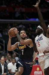 October 9, 2018 - Anaheim, California, U.S - Montrezl Harrell #5 of the Los Angeles Clippers tries to block Trey Lyles #7 of the Denver Nuggets as he drives to the basket during their NBA preseason game on Tuesday October 9, 2018 at the Staples Center in Los Angeles, California. Clippers defeat Nuggets, 109-103. (Credit Image: © Prensa Internacional via ZUMA Wire)