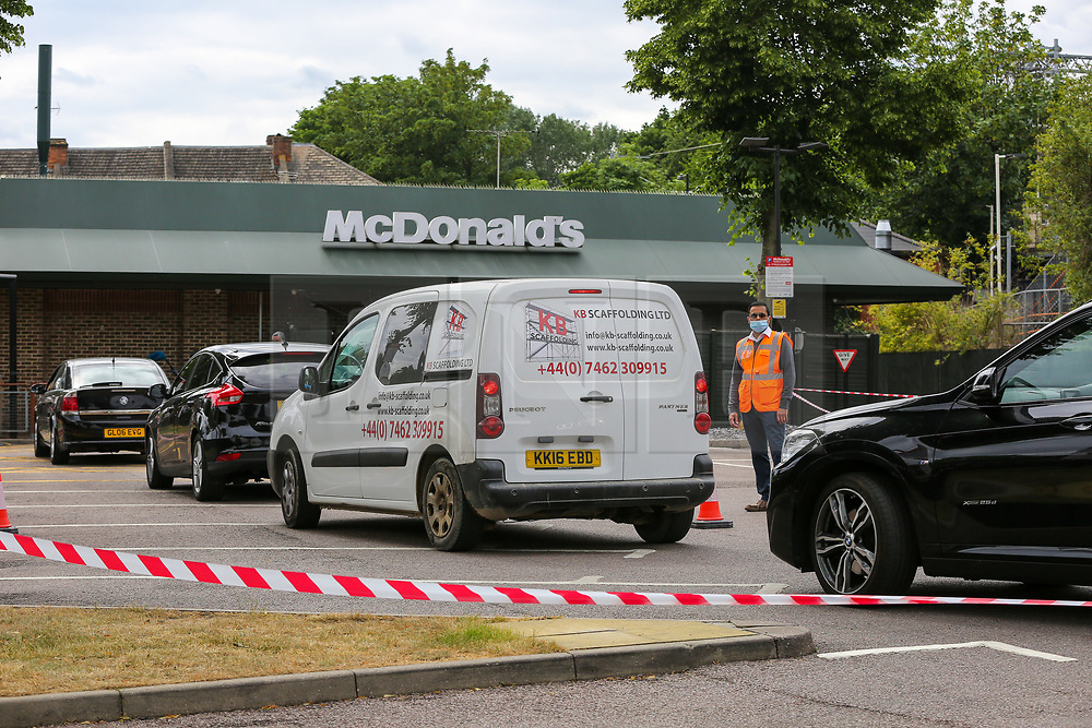 © Licensed to London News Pictures. 04/06/2020. London, UK. A queue of vehicles at McDonald's Drive Thru in north London. McDonald's Drive Thru opens in Haringey, after lockdown restrictions are relaxed. Photo credit: Dinendra Haria/LNP