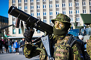 Tallinn, Estonia - February 24, 2020: Portrait of an Estonian soldier at Freedom Square in Tallinn, Estonia, displaying weapons as part of Estonian Independence Day celebrations.