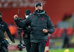 LIVERPOOL, ENGLAND - Wednesday, December 16, 2020: Liverpool's manager Jürgen Klopp celebrates in front of the supporters  during the FA Premier League match between Liverpool FC and Tottenham Hotspur FC at Anfield. Liverpool won 2-1. (Pic by David Rawcliffe/Propaganda)
