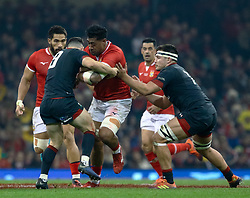 Daniel Faleafa of Tonga is tackled by Tomos Williams of Wales<br /> <br /> Photographer Simon King/Replay Images<br /> <br /> Under Armour Series - Wales v Tonga - Saturday 17th November 2018 - Principality Stadium - Cardiff<br /> <br /> World Copyright © Replay Images . All rights reserved. info@replayimages.co.uk - http://replayimages.co.uk