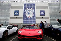 Fans take photographs of the Lamborghini's parked outside Cardiff City stadium