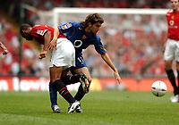 Francesc Fabregas <br /> Arsenal 2004/05<br /> David Bellion Manchester United<br /> Arsenal v Manchester United <br /> The Community Shield 08/08/04<br /> Photo Robin Parker, Digitalsport