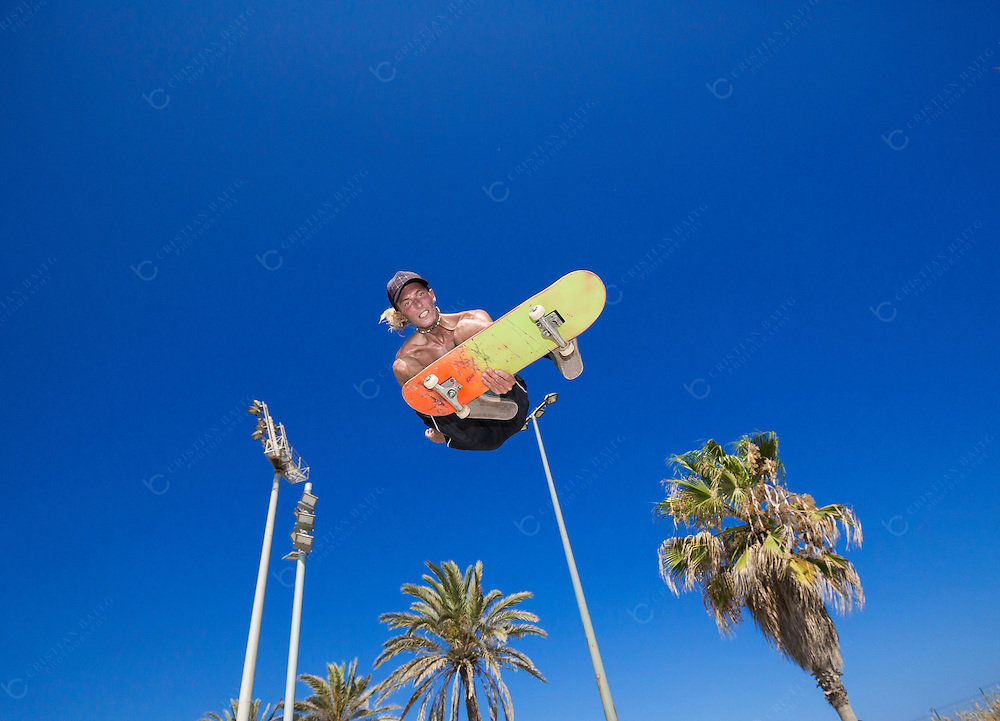 Young man high jump with skateboard