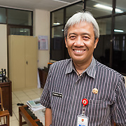 CAPTION: Mr Purnomo is part of the City Core Team, and is from the Development and Planning Agency (BAPPEDA). He notes that since the City Core Team was established, both interdepartmental coordination, as well as coordination with government partners and external stakeholders, have increased. He has recently been working alongside the local NGO Bintari and the nearby university to implement flood early warning systems in several flood-prone communities. Mr Purnomo says that collaboration between various stakeholders, and the sharing of knowledge, have benefited the project hugely. LOCATION: Development and Planning Agency Office (BAPPEDA), Semarang, Indonesia. INDIVIDUAL(S) PHOTOGRAPHED: Purnomo Dwi Sasoneko.
