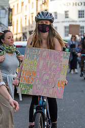 © Licensed to London News Pictures. 03/04/2021. Bristol, UK. A protester riding a bike holds a placard during the 'Kill the Bill' demonstration in Bristol. Crowds gathered to protest against the proposed Police, Crime, Sentencing and Courts Bill. Photo credit: Peter Manning/LNP