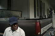 PANOLA, AL – OCTOBER 9, 2015: Leroy James, 71, sits outside his home on Highway 34. Due to state budget cuts, Alabama announced the closure of 31 of its driver's license offices in mostly rural sections of the state, where poverty is high and transportation is notoriously difficult. Critics argue the closures are an attempt to limit accessibility to photo IDs – which are now required for voting – but state officials insist that the closings have no effect on access to photo ID. CREDIT: Bob Miller for The New York Times