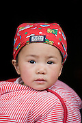 Baby girl in Fuli Old Town, Xingping, China
