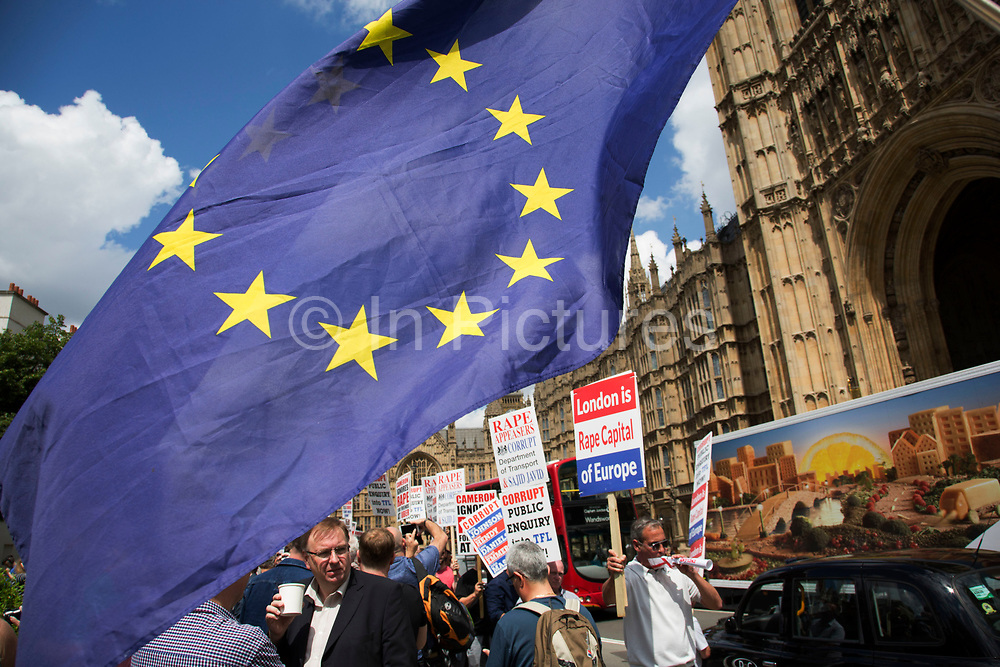 Protester waving an EU flag at College Green in Westminster outside the Houses of Parliamant following a Leave vote, also known as Brexit as the EU Referendum in the UK votes to leave the European Union on June 24th 2016 in London, United Kingdom. Membership of the European Union has been a topic of debate in the UK since the country joined the EEC, or Common Market in 1973. It will be the second time the British electorate has been asked to vote on the issue of Britains membership: the first referendum being held in 1975, when continued membership was approved by 67% of voters. The two sides are the  Leave Campaign, commonly referred to as a Brexit, and those of the Remain Campaign who are also known as the In Campaign.