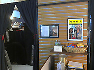 Lindenhurst, New York, USA. September 23, 2018.  Reflected in Playbill mirror in lobby of The Parlor of Mystery are, L-R, LAURA YORBURG, ANN PARRY, and behind her, BOB YORBURG, who was one of the four magicians who performed in the Magic Comedy Show that night at South Shore Theatre Experience. Parry captured image with iPhone 8S.