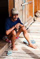Man sitting at Nanga Sumpa Longhouse, Sarawak.