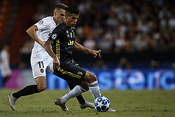September 19, 2018 - Valencia, Valencia, Spain - Joao Cancelo (R) of Juventus competes for the ball with Denis Cheryshev of Valencia CF during the UEFA Champions League group H match between Valencia CF and Juventus at Mestalla on September 19, 2018 in Valencia, Spain  (Credit Image: © David Aliaga/NurPhoto/ZUMA Press)