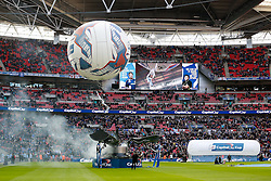 An acrobat suspended from a balloon collects the League Cup Trophy before kick off - Photo mandatory by-line: Rogan Thomson/JMP - 07966 386802 - 01/03/2015 - SPORT - FOOTBALL - London, England - Wembley Stadium - Chelsea v Tottenham Hotspur - Capital One Cup Final.