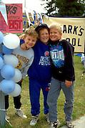 10 year olds taking a break at Catholic school walk a thon fund raiser.  St Paul  Minnesota USA