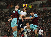 Football - 2018 / 2019 Premier League - Tottenham Hotspur vs. Burnley<br /> <br /> Harry Kane (Tottenham FC)  rises between Kevin Long (Burnley FC) and Phillip Bardsley (Burnley FC) as the cross is whipped in at Wembley Stadium.<br /> <br /> COLORSPORT/DANIEL BEARHAM
