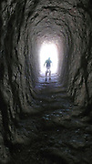 A hiker passes through the Balconies Cave at Pinnacles National Monument in<br /> Paicines, California, USA.