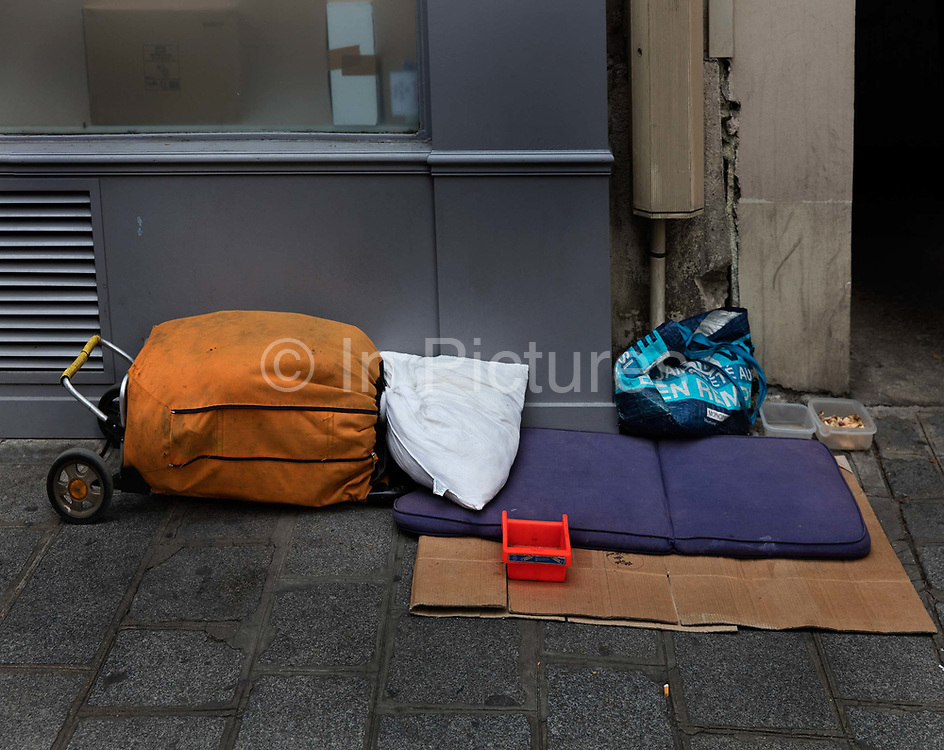Bed in the street waiting for a homeless man, Marais, Paris.