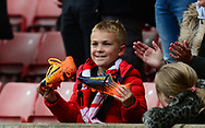 a young Stoke city fan shows his delight after Marko Arnautovic of Stoke city gives him his boots . Premier league match, Stoke City v West Ham Utd at the Bet365 Stadium in Stoke on Trent, Staffs on Saturday 29th April 2017.<br /> pic by Bradley Collyer, Andrew Orchard sports photography.