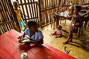 Children having a meal at Zinha's kiosk, in Santo António do Príncipe