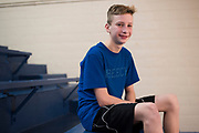 Nicolas Crouse, 13, poses for a portrait before a 7th grade basketball game at Durant Middle School in Durant, Oklahoma on January 27, 2017.  (Cooper Neill for The New York Times)