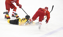 PYEONGCHANG, Feb. 25, 2018  Marcel Noebels (C) of Germany vies for the puck during men's ice hockey final against Olympic athletes from Russia at Gangneung Hockey Centre, in Gangneung, South Korea, Feb. 25, 2018. The Olympic Athletes from Russia team defeated Germany 4:3 and won the gold medal. (Credit Image: © Han Yan/Xinhua via ZUMA Wire)