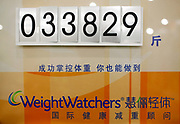 A board showing total weight loss achieved (in catties, or units of half kilograms)at the WeightWatchers center in Shanghai, China on 12 May 2010. An increasing number of Chinese people, especially those who live in cities, are becoming obese due to high caloric and protein diet, a problem that is almost unheard of just a generation ago.