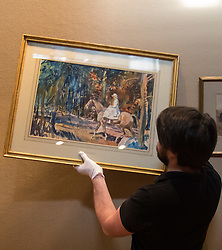 """Bonhams, Mayfair, London, February 26th 2016. A gallery technician hangs """"Portrait of Mrs Abigail Prince"""" by Sir Alfred Munnings estimated to fetch between £40-60,000 at the Bonhams 19th Century Art Sale in Mayfair, London on March 2nd 2016. ///FOR LICENCING CONTACT: paul@pauldaveycreative.co.uk TEL:+44 (0) 7966 016 296 or +44 (0) 20 8969 6875. ©2015 Paul R Davey. All rights reserved."""