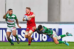 Scarlets' James Davies is tackled by Benetton Treviso's Tommaso Allan<br /> <br /> Photographer Simon King/Replay Images<br /> <br /> EPCR Champions Cup Round 3 - Scarlets v Benetton Rugby - Saturday 9th December 2017 - Parc y Scarlets - Llanelli<br /> <br /> World Copyright © 2017 Replay Images. All rights reserved. info@replayimages.co.uk - www.replayimages.co.uk