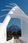 Mount Taranaki framed by the Te Rewa Rewa Bridge over the Waiwhakaiho River, in New Plymouth, New Zealand.