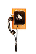 old black telephone, isolated on white background