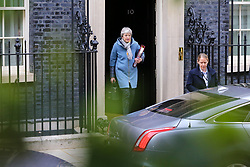 "© Licensed to London News Pictures. 20/03/2019. London, UK. British Prime Minister Theresa May departs from Number 10 Downing Street to attend Prime Minister's Questions (PMQs) in the House of Commons. According to No 10 Downing Street, later today Theresa May will write to European Union chiefs requesting a ""short"" delay to the date Britain leaves the EU. Photo credit: Dinendra Haria/LNP"