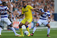 Tjarron Chery of QPR ®  & Olamide Shodipo of QPR (l)  intercept Kyle Bartley of Leeds United. Skybet EFL championship match, Queens Park Rangers v Leeds United at Loftus Road Stadium in London on Sunday 7th August 2016.<br /> pic by John Patrick Fletcher, Andrew Orchard sports photography.