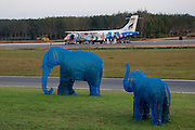 A Bangkok Airways ATR 72 coming from Bangkok is greeted by bushes being grown into elephant shape.