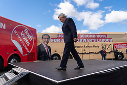 Glasgow, Scotland, UK. 5 May 2021. Scottish Labour Leader Anas Sarwar and former Prime Minister Gordon Brown appear at an eve of polls drive-in campaign rally in Glasgow today.  Pic; Gordon Brown leaves stage after speech. Iain Masterton/Alamy Live News