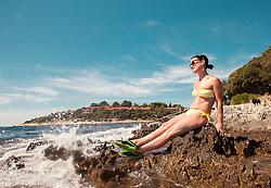 THEMENBILD - URLAUB IN KROATIEN, eine junge Frau genießt die Sonne am Strand, aufgenommen am 03.07.2014 in Vrsar, Kroatien // a young woman enjoying the sun at the beach near Vrsar, Croatia on 2014/07/03. EXPA Pictures © 2014, PhotoCredit: EXPA/ JFK