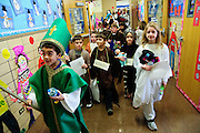 """Second grade students at St. Michael School in Orland Park portray their favorite religious figures during the school's annual Parade of Saints, February 2. During the event, costumed students stand motionless in the school commons for parents, grandparents and friends to """"activate"""" the Saint, who will offer a brief historical description. The session is followed by a parade through the school. Brian J. Morowczynski/ViaPhotos."""