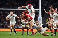 Jamie Roberts of Wales is tackled by Sam Burgess of England (on ground) to stop a Welsh attack. Rugby World Cup 2015 pool A match, England v Wales at Twickenham Stadium in London, England  on Saturday 26th September 2015.<br /> pic by  Andrew Orchard, Andrew Orchard sports photography.