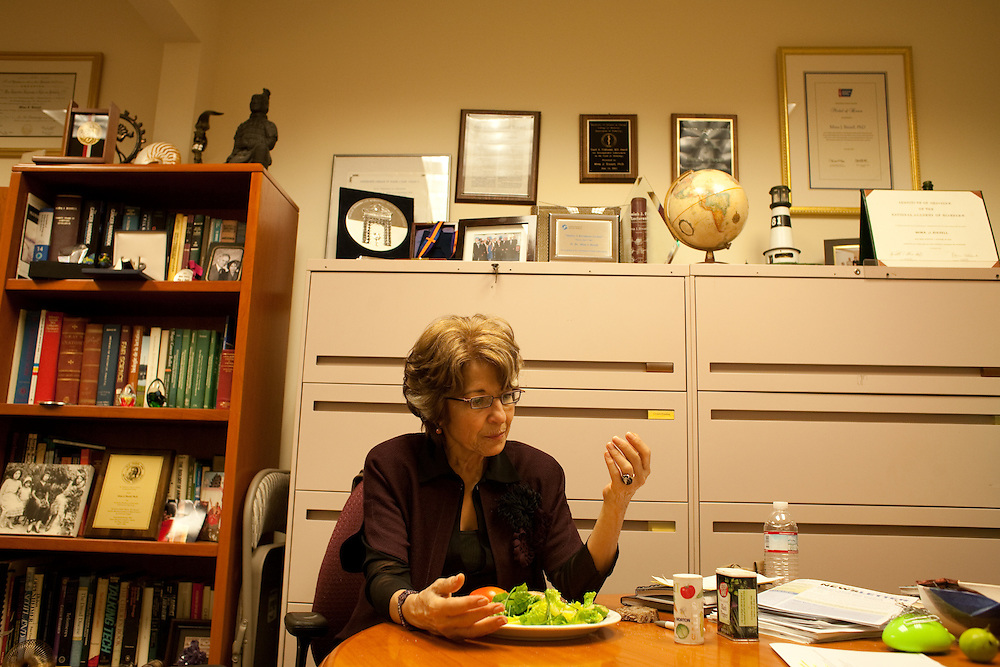 Dr. Bissell eats lunch in her office while dictating a memo to her senior administrator Negest Williams (not pictured), on December 18, 2009.