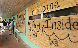 October 7, 2016 - Tallahassee, Florida, U.S. - Patrons gather on the porch during a ''Hurricane Party'' at The Oyster Troff in Eustis. The business was boarded up in preparation for Hurricane Matthew. (Credit Image: © Stephen M. Dowell/TNS via ZUMA Wire)