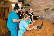 nurses looking at the computer in a nursing home in Boulder, Colorado