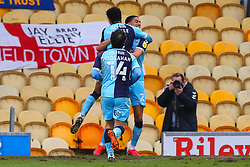 Harvey Knibbs of Cambridge United celebrates his goal with Kyle Knoyle and Jubril Okedina - Mandatory by-line: Ryan Crockett/JMP - 20/02/2021 - FOOTBALL - One Call Stadium - Mansfield, England - Mansfield Town v Cambridge United - Sky Bet League Two