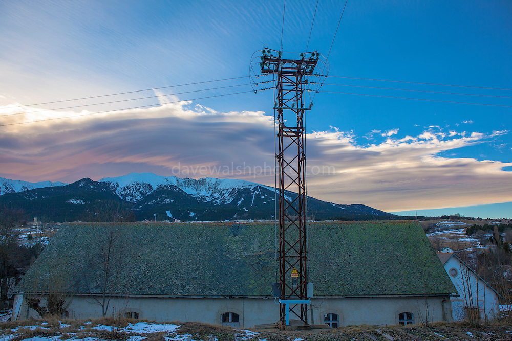 Lenticular clouds seen from Mont Louis La Cabanesse station and the Train Jaune. The Yellow Train, Canari, or Ligne de Cerdagne, is a 63km long railway from Villefranche-de-Conflent to Latour-de-Carol, rising from 427m to 1,593m at Bolquère-Eyne, the highest railway station in France. In early 2015 the future of the line was uncertain, with SNCF and the French government considering either to close the line, or to privatise it for tourism use.